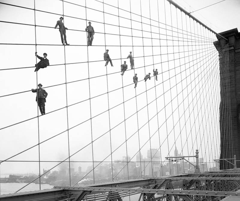 hanging-out-on-brooklyn-bridge-cables-black-and-white-old-vintage