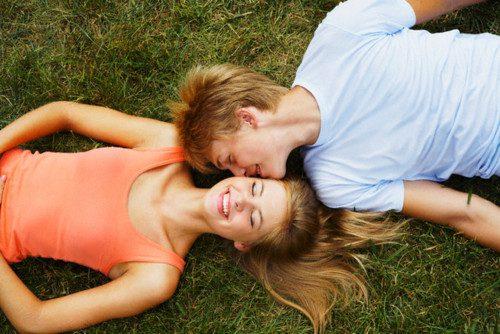 Teenage Boy Kissing Girlfriend's Cheek