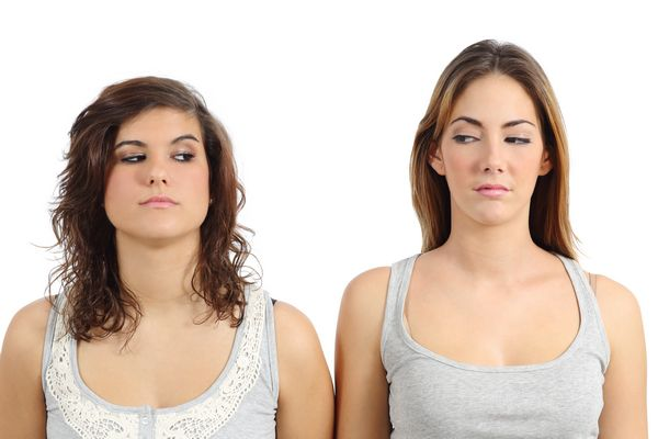Two girls looking each other angry