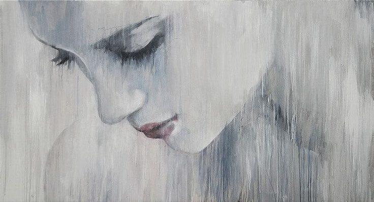 Mujer-triste-mirando-hacia-abajo