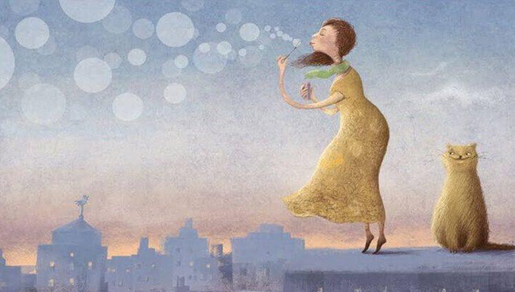 menina soprando bolhas de sabão junto com um gato