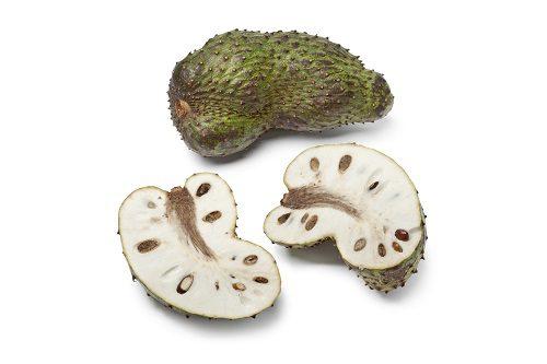 Fresh whole and half soursop fruit on white background