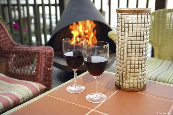 Wine glasses on table near fireplace
