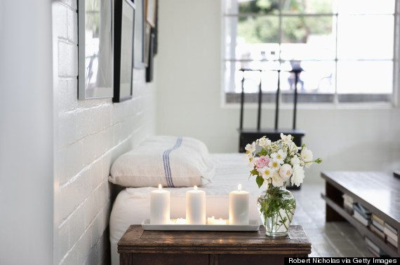 Lit candles and bouquet in living room