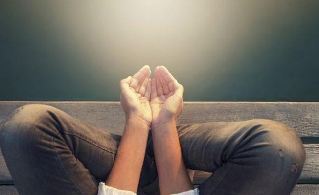 calm woman meditating reciving power by light
