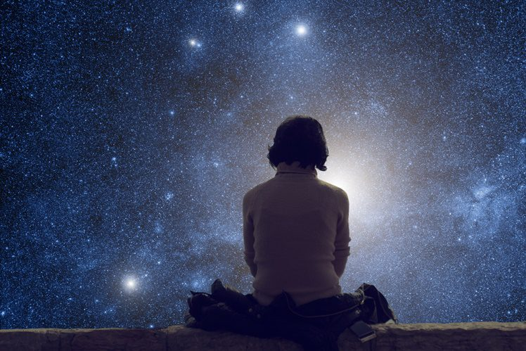 Girl watching the starry skies.
