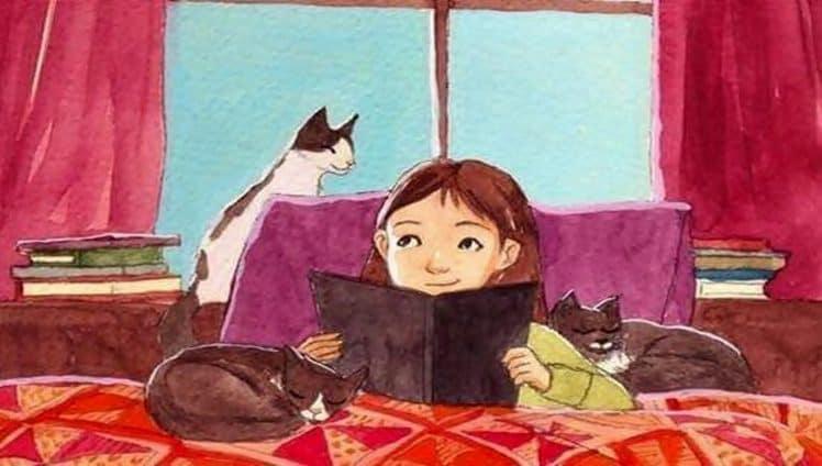 Menina-lendo-um-livro-rodeada-de-gatos