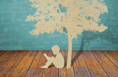 Menino-lendo-debaixo-de-uma-árvore