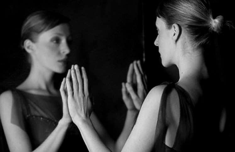 Woman Looking at Reflection --- Image by © Elisa Lazo de Valdez/Corbis