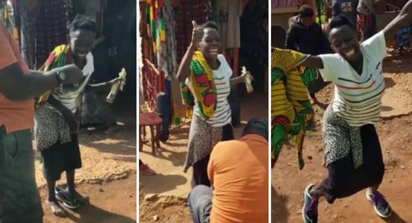 mulher africana faz linda dança de celebração após ganhar primeiro par de sapatos da vida