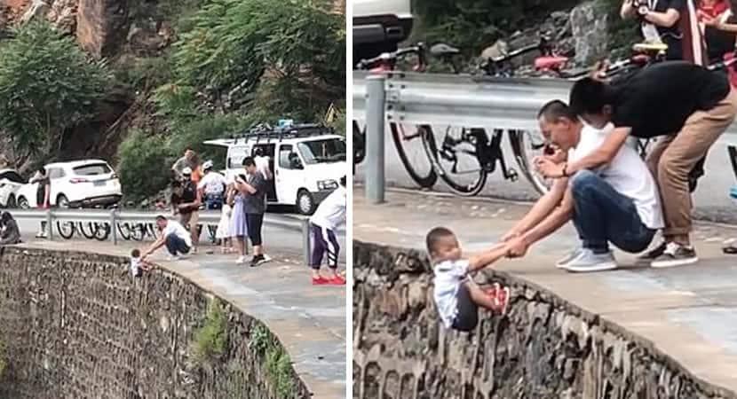 pai desperta revolta ao ser filmado segurando filho a beira de penhasco para tirar foto